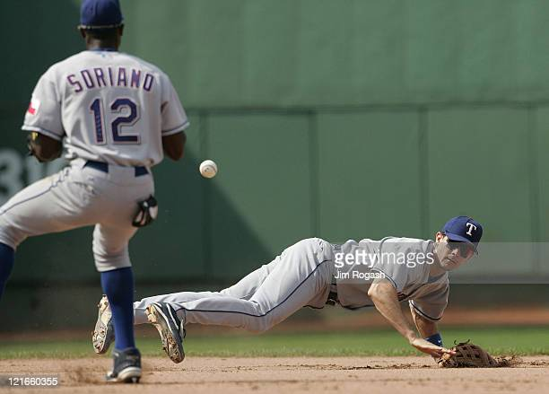 Against the Boston Red Sox Texas Rangers shortstop Michael Young right flips the ball to second baseman Alfonso Soriano for the out The Rangers beat...