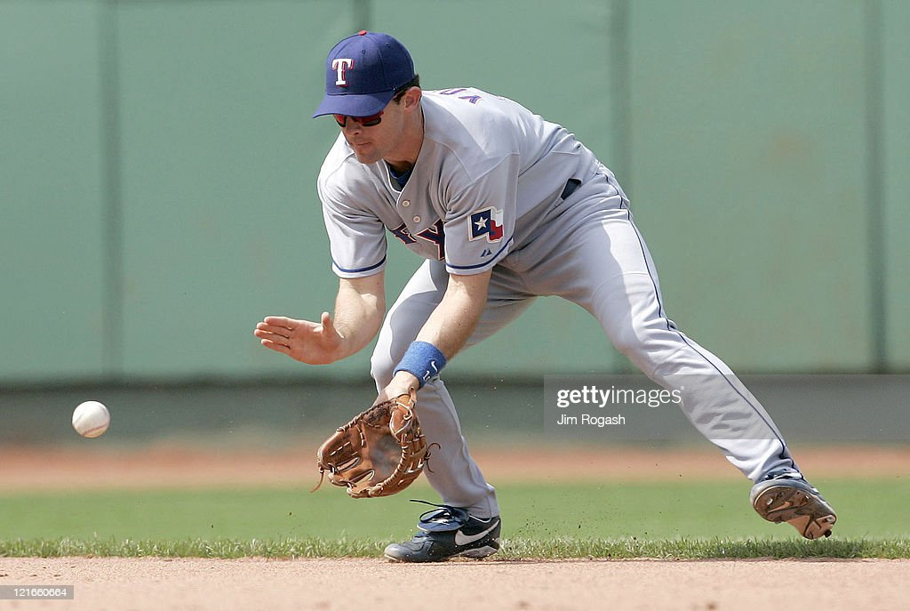 Against the Boston Red Sox Texas Rangersshortstop Michael Young males the play The Rangers beat the Red Sox 65 at Fenway Park in Boston Massachusetts...