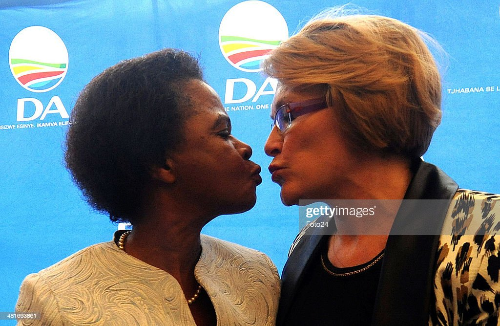 Agang leader <a gi-track='captionPersonalityLinkClicked' href=/galleries/search?phrase=Mamphela+Ramphele&family=editorial&specificpeople=3973045 ng-click='$event.stopPropagation()'>Mamphela Ramphele</a> and DA leader <a gi-track='captionPersonalityLinkClicked' href=/galleries/search?phrase=Helen+Zille&family=editorial&specificpeople=869313 ng-click='$event.stopPropagation()'>Helen Zille</a> kiss during a press conference on January 28, 2014 in Cape Town, South Africa. The Democratic Alliance has announced that Dr Ramphele will be the DA Presidential candidate for the upcoming general elections.