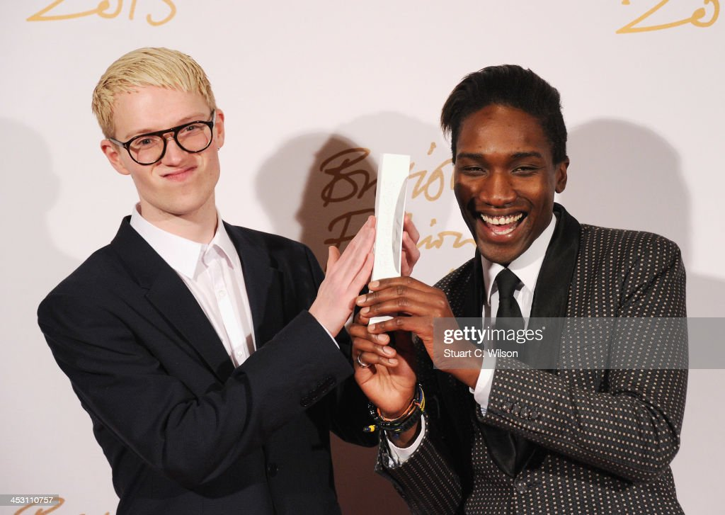 Agape Mdumulla and Sam Cotton with the award for Emerging Menswear Designer pose in the winners room at the British Fashion Awards 2013 at London Coliseum on December 2, 2013 in London, England.
