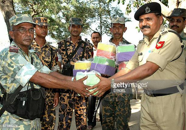 Bangladesh Rifles personnel and Indian Border Security Force personnel greet each other with sweets at the Akhaura Checkpost in Agartala 26 March...