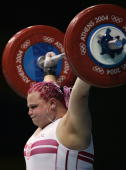 Agata Wrobel of Poland feels the strain as she successfully makes a lift in the women's over 75 kg category weightlifting competition on August 21...