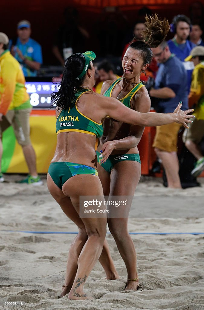 Agatha Bednarczuk Rippel and Barbara Seixas De Freitas of Brazil celebrate winning the beach volleyball Women's Semi final against Kerri Walsh Jennings and April Ross of the United States on Day 11 of the Rio 2016 Olympic Games at the Beach Volleyball Arena on August 16, 2016 in Rio de Janeiro, Brazil.