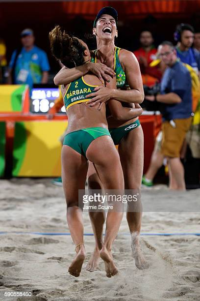 Agatha Bednarczuk Rippel and Barbara Seixas De Freitas of Brazil celebrate winning the beach volleyball Women's Semi final against Kerri Walsh...