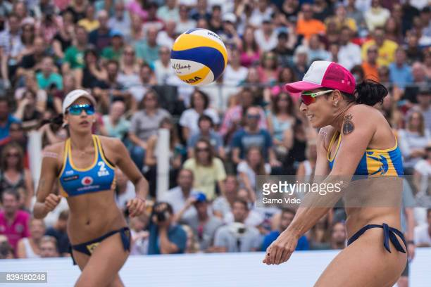 Agatha Bednarczuk Rippel of Brazil receives the ball during the gold medal match against Laura Ludwig and Kira Walkenhorst of Germany during Day 4 of...