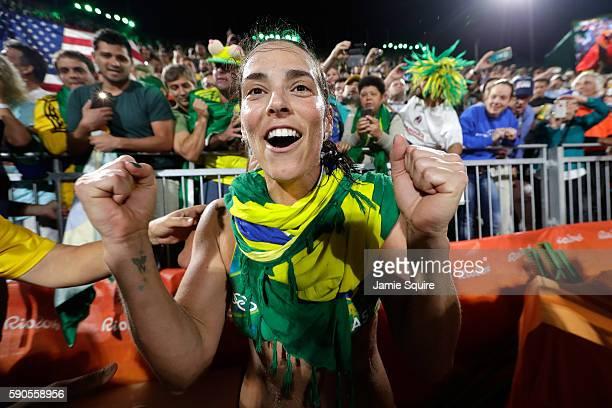 Agatha Bednarczuk Rippel playing with Barbara Seixas De Freitas of Brazil celebrates winning the beach volleyball Women's Semi final against Kerri...