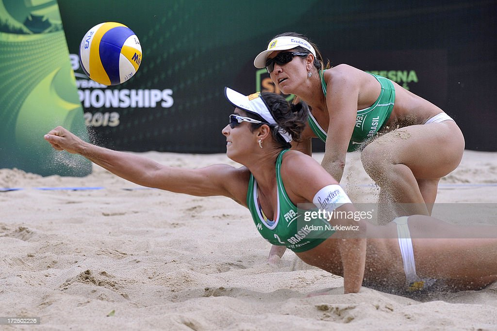 Agatha Bednarczuk (L) saves the ball next to Maria Antonelli (R) of Brazil during Day 2 of the FIVB World Championships on July 2, 2013 in Stare Jablonki, Poland.
