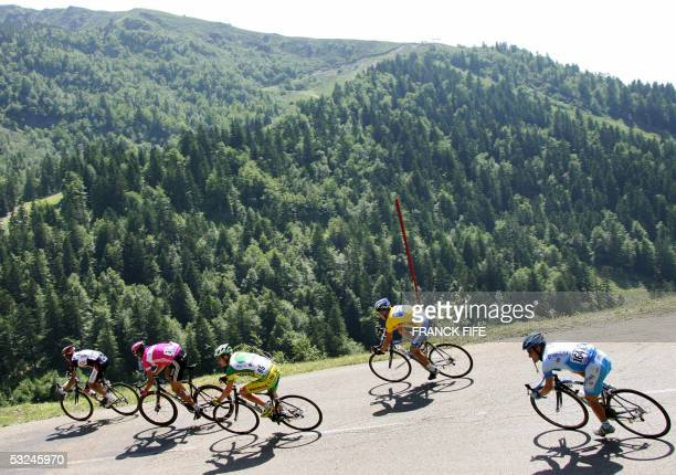 The breakaway cyclists Italian Ivan Basso German Jan Ullrich US Floyd Landis yellow jersey US Lance Armstrong and Austrian Georg Totschnig ride...