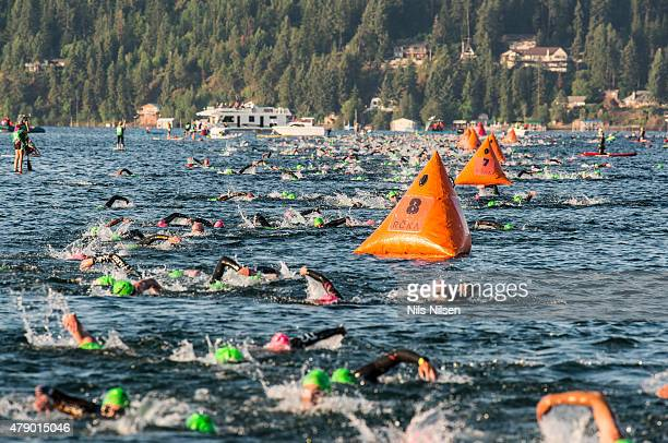 Age group athletes swim during the first leg of IRONMAN Coeur d'Alene June 28 2015 in Coeur d'Alene Idaho