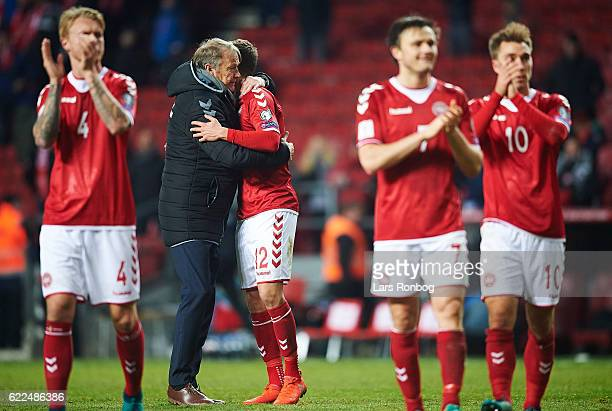 Age Hareide head coach of Denmark and Andreas Bjelland of Denmark celebrate after the FIFA 2018 World Cup Qualifier match between Denmark and...
