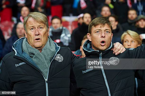 Age Hareide head coach of Denmark and Jon Dahl Thomasson assistant coach of Denmark sing during the national anthem prior to the FIFA 2018 World Cup...