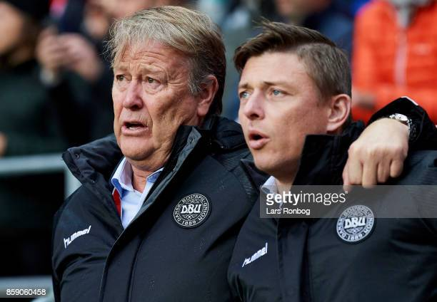 Age Hareide head coach of Denmark and Jon Dahl Tomasson assistant coach of Denmark during the national anthem prior to the FIFA World Cup 2018...