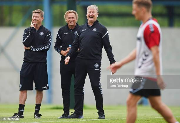 Age Hareide head coach of Denmark laughing with Jon Dahl Tomasson and goalkeeper coach Lars Hoegh during the Denmark training session at Brondby...