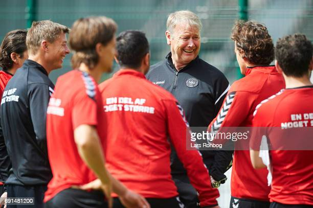 Age Hareide head coach of Denmark speaks to Thomas Delaney prior to the Denmark training session at Brondby Stadion on June 2 2017 in Brondby Denmark
