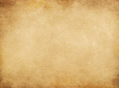 Old stained paper background. Rustic and grunge paper texture for the design.
