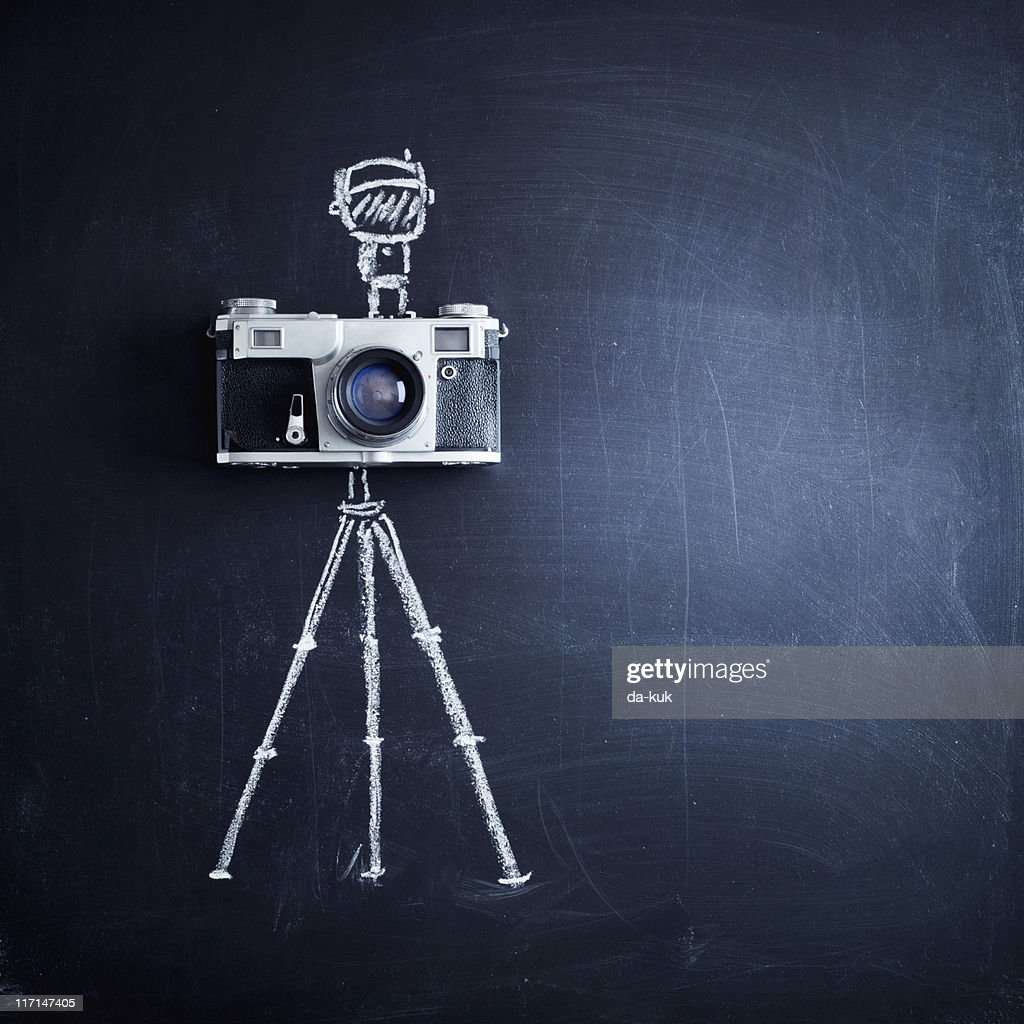 Aged camera on tripod : Stock Photo