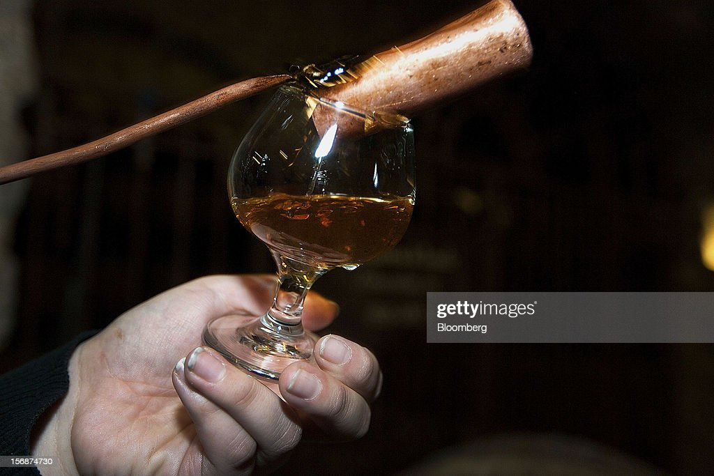 Aged tequila is poured into a glass to be served at the Tequila Cuervo La Rojena S.A. de C.V., maker of Jose Cuervo, distillery plant in Guadalajara, Mexico, on Thursday, Nov. 22 2012. There are more than 200 types of agave in Mexico, but use of the blue agave plant was made compulsory in the last century to the issuance of the Official Mexican Standard for Tequila production. Photographer: Susana Gonzalez/Bloomberg via Getty Images