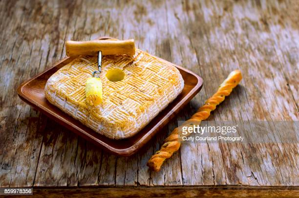 Aged Ukrainian artisanal cheese with grisini bread  stick and corkscrew