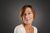 Face of senior woman looking at camera