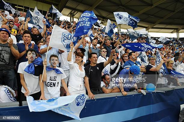 Agen supporters celebrate after winning the pro D2 final against MontdeMarsan at the Ernest Wallon stadium in Toulouse on May 24 2015 Agen won 1615...