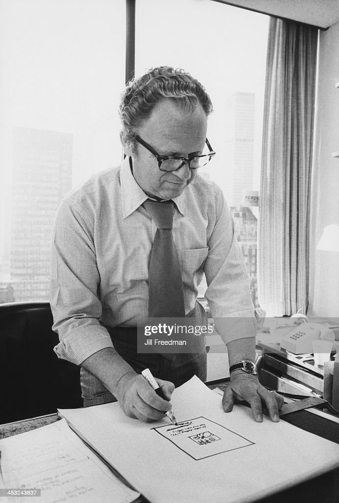 Agency Art Director Jos Schindelman at his desk in the office of the 'Scali McCabe Sloves' advertising agency, Madison Avenue, New York City, 1976.