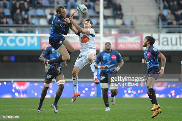 Agen's Benoit Sicard vies with Montpellier's Jesse Mogg during the French Top 14 rugby Union match Montpellier vs Agen on December 27 at the Altrad...