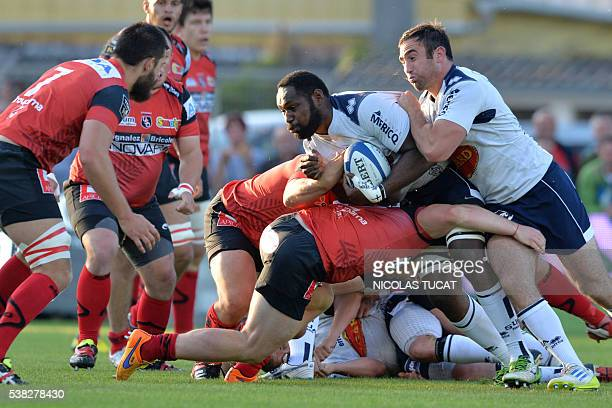 Agen's Fijian lock Apisalome Ratuniyarawa runs with the ball during the French Top 14 rugby union match between Agen and Oyonnax on June 5 2016 at...