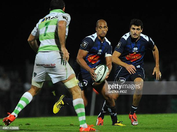 Agen's flyhalf Burton Francis runs with the ball during the French Top 14 rugby union match between Pau and Agen at the Hameau stadium on November 7...