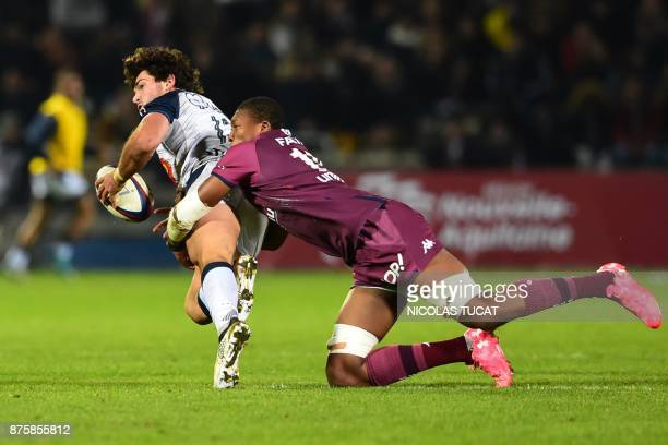 Agen's French centre Pierre Fouyssac is tackled during the French Top 14 rugby union match between BordeauxBegles and Agen on November 18 2017 at the...