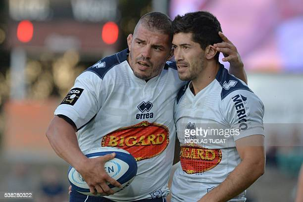 Agen's French hooker Jalil Narjissi reacts with a Agen's mathieu Lamoulie during the French Top 14 rugby union match between Agen and Oyonnax on June...