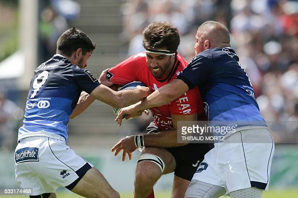 Agen's player Clement Darbo and Jalil Narjissi vie with Toulon's player Juan Martin Fernandez Lobbe during the French Top 14 rugby union match...