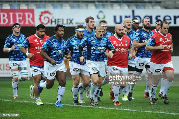 Agen's players warm up before the French Top 14 rugby Union match Montpellier vs Agen at the Altrad stadium in the French southern city of...