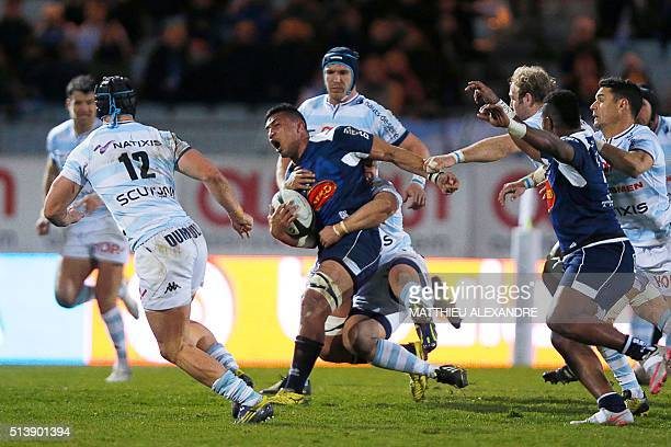 Agen's Tongan flanker Sione Tau is tackled during the French Top 14 rugby union match between Racing 92 and Agen on March 5 at YvesduManoir stadium...