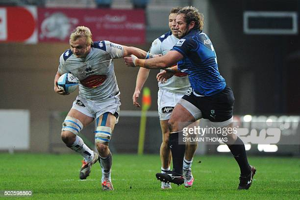 Agen's Welsh flanker Luke Hamilton vies with Montpellier's South African hooker Bismarck Du Plessis during the French Top 14 rugby Union match...