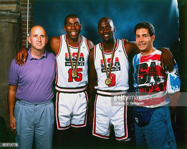 Agent David Falk poses with Magic Johnson and Michael Jordan of USA Basketball for a photo after winning the gold medal of the 1992 Olympics in 1992...