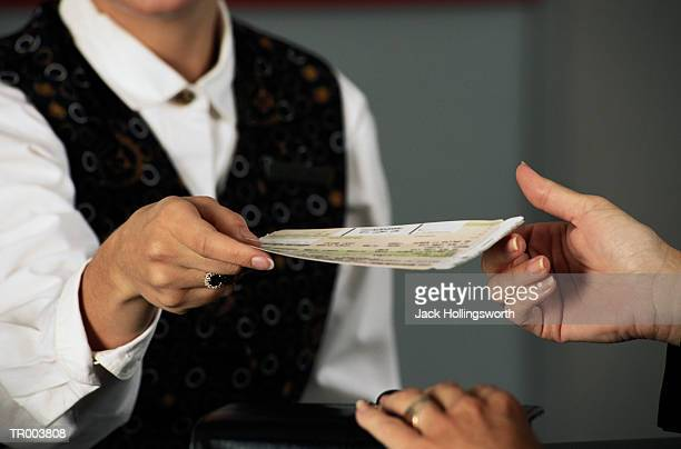 Agent Handing Ticket to Woman