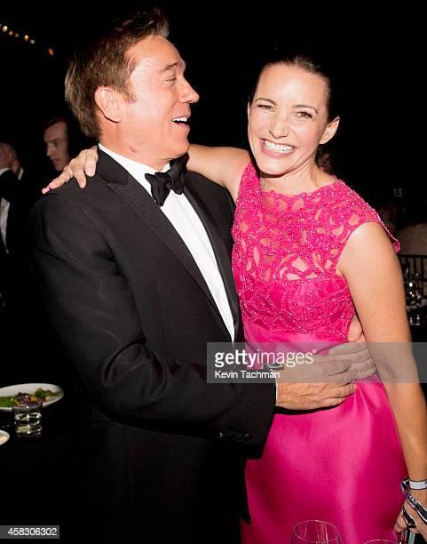 Agent Kevin Huvane and Kristin Davis attend amfAR LA Inspiration Gala honoring Tom Ford at Milk Studios on October 29 2014 in Hollywood California
