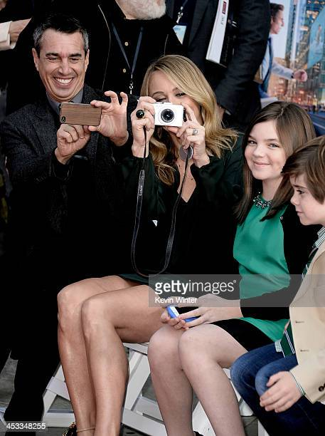 Agent Nick Stevens actress Christine Taylor and her children Ella Stiller and Quinlin Stiller watch as actor Ben Stiller is honored with a hand and...