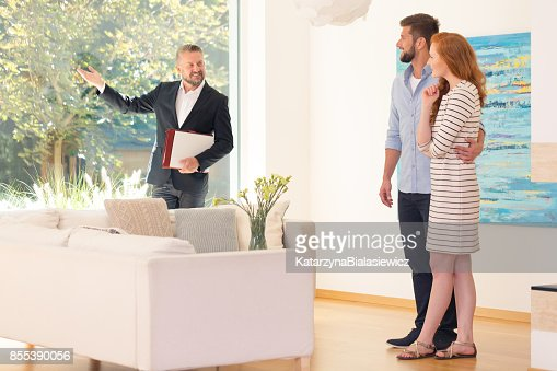 Agent showing home interior : Stock Photo