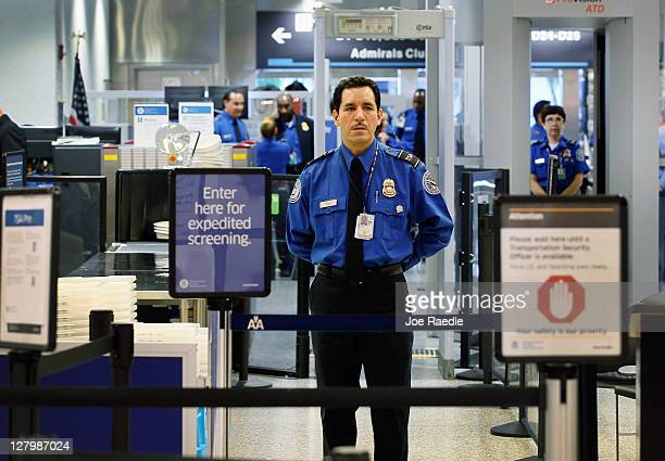 TSA agent waits for passengers to use the TSA PreCheck lane being implemented by the Transportation Security Administration at Miami International...