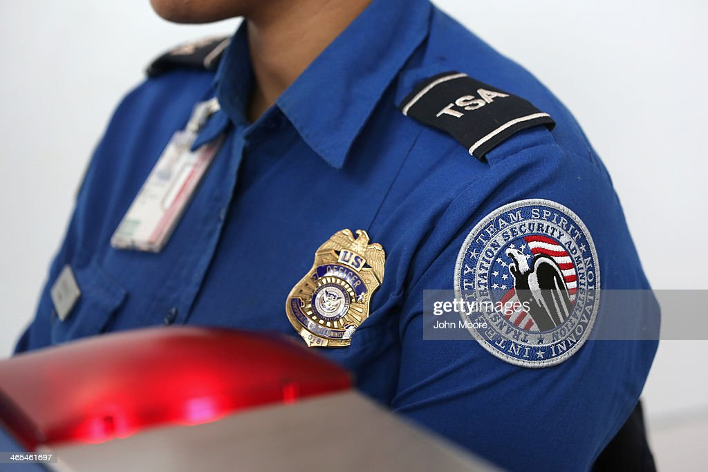 A TSA agent watches an xray monitor while screening luggage at a special TSA Pre-check lane at Terminal C of the LaGuardia Airport on January 27, 2014 in New York City. Once approved for the program, travelers can use special expidited Precheck security lanes. They can also leave on their shoes, light outerwear and belt, as well as keep their laptop and small containers of liquids inside carry-on luggage during security screening. The TSA plans to open more than 300 application centers across the country.