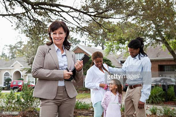 Agent with family outside house
