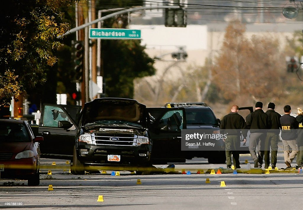 FBI agents and local law enforcement examine the crime scene where suspects of the Inland Regional Center were killed on December 3 2015 in San...