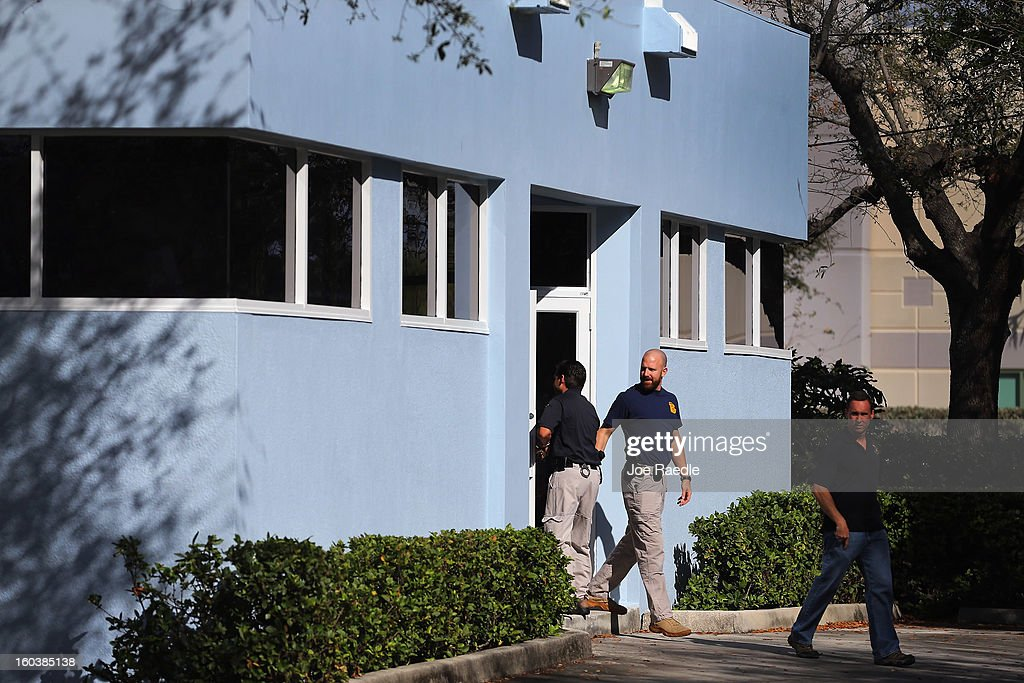 FBI agents and other law enforcement officials are seen as they investigate at the medical-office complex of Dr. Salomon Melgen who has possible ties to U.S. Sen. Bob Menendez (D-NJ) on January 30, 2013 in West Palm Beach, Florida. The agents arrived last night at the medical-office complex and started taking away potential evidence in several vans.