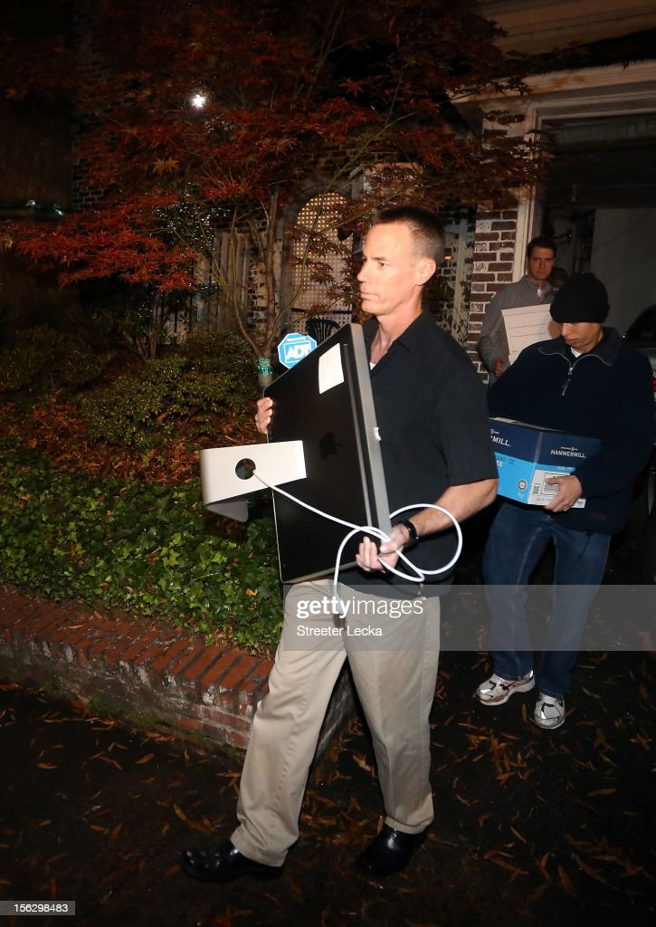FBI agents carry out a computer and boxes after a search of the home of Paula Broadwell on November 13, 2012 in the Dilworth neighborhood of Charlotte, North Carolina. Broadwell is the recently discovered mistress of CIA Director David Petraeus, which has led to his resignation in light of the scandal.