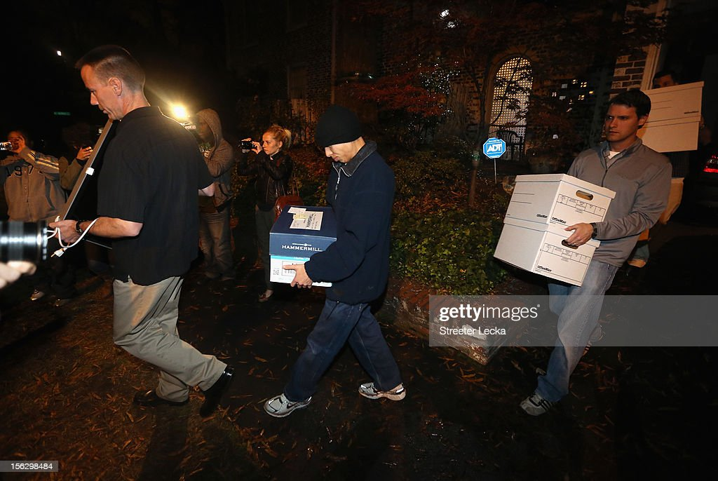 FBI agents carry out boxes after a search of the home of Paula Broadwell on November 13, 2012 in the Dilworth neighborhood of Charlotte, North Carolina. Broadwell is the recently discovered mistress of CIA Director David Petraeus, which has led to his resignation in light of the scandal.
