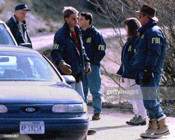 FBI agents guard the entrance to the property of Theodore Kaczynski the 53yearold Harvard graduate suspected of an 18year terrorist letter bomb...