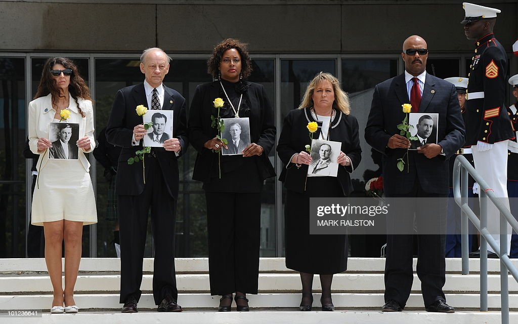 FBI agents hold photos of deceased colleagues, during a memorial service for Special Agents and their law enforcement and military colleagues killed in the line of duty, at the Federal Building in Los Angeles on May 28, 2010. Memorial Day, which was formerly known as Decoration Day, commemorates US men and women who died while in the service to their country and was first enacted to honor Union soldiers of the American Civil War. AFP PHOTO/Mark RALSTON