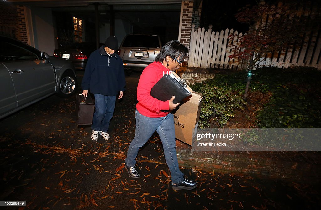 FBI agents leave the home of Paula Broadwell after a search on November 13, 2012 in the Dilworth neighborhood of Charlotte, North Carolina. Broadwell is the recently discovered mistress of CIA Director David Petraeus, which has led to his resignation in light of the scandal.
