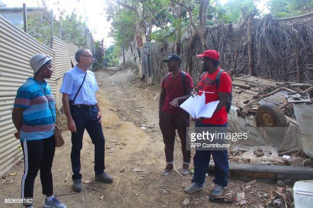 Agents of the census services walk in a street of La Vigie in PetiteTerre on the Mozambique channel French archipelago of Mayotte on September 22 as...